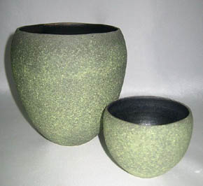 Two hollow open forms - light green matt glaze