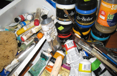 Collection of paints, sponges and brushes