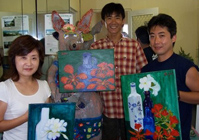 Students from the Regent Language School show off their paintings