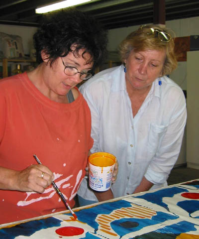 Robin and Jill hand paint their screenprint