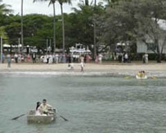 The bride is rowed to shore in a dinghy
