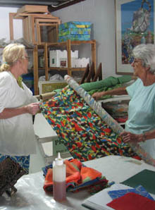 Gail and Jill discuss possibilities of painting and printing on silk.