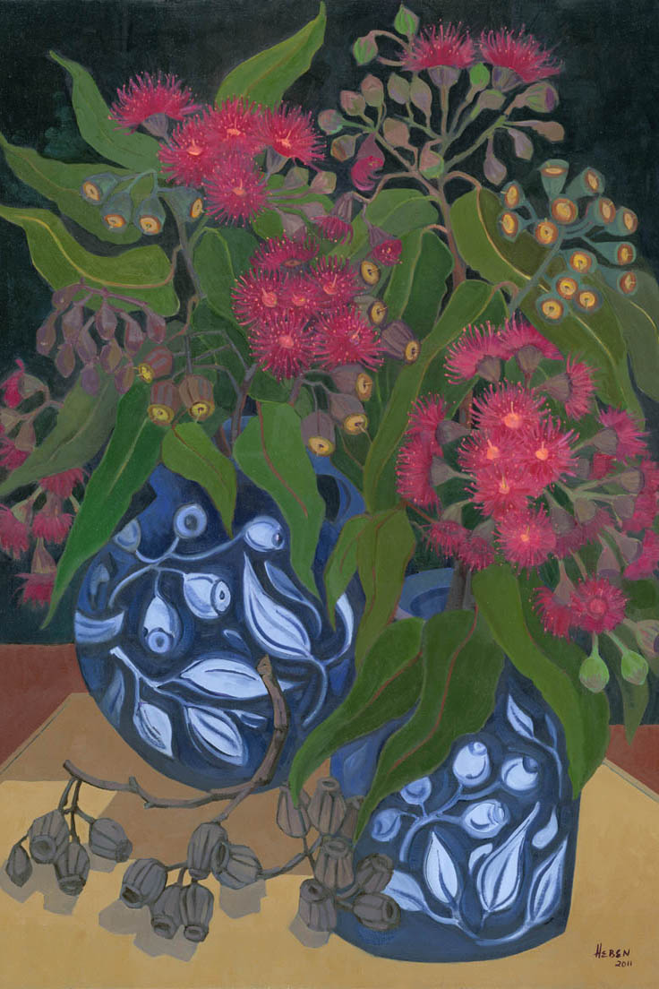 Two blue patterned vases hold bunches of Blood Gums red flowers