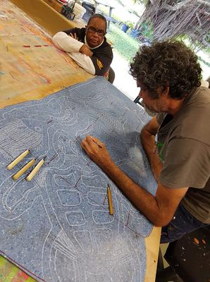 Artists from Yarrabah creating their linocut for the BIG PRINT