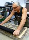 Theo Tremblay printing a stone lithograph