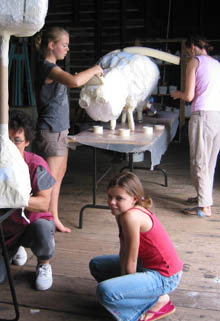 Children and adults collaborate on sculptures