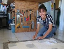 Anna Curtis works on a new lino-print in her Port Douglas studio.