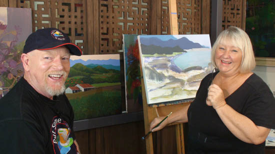 Graeme watches Tania working on a new painting of the Daintree coast - they seem to be enjoying themselves!