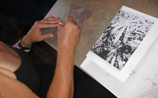 Student hand engraves perspex sheet for etching plate