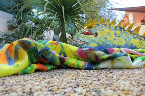 A ceramic 'dragon' makes friends with a matching silk scarf!