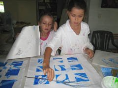 Olivia and Jasmin with their block printing using leaves