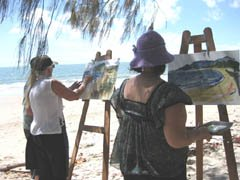 Christine and students paint on Four Mile Beach