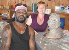 Student sculptor with portrait sculpture and model