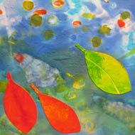 red and yellow collaged paper leaves float on silk 'water'