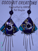 triangular blue and gold painted coconut earrings with silver wires hanging below