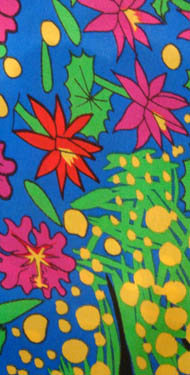Linda Jackson screen printed fabric length - yellow wattle and red hibiscus with green leaves on a blue background
