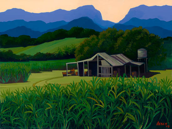 Farm shed on sugar plantation, mountains in the background.