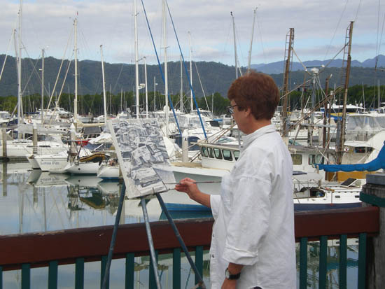 Mary Ann works on a favourite subject of hers - boats in Port Douglas Marina.