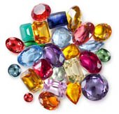 group of colourful tumbled or cut polished precious and semi-precious australian gemstones.