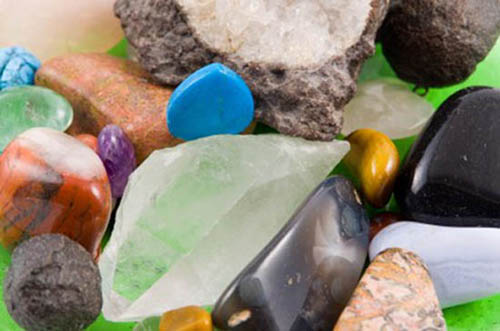 Collection of rough and tumbled Australian gemstones, including amethyst