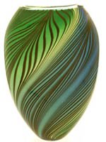 Green leaves swirl around this elegant glass vase