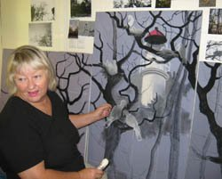Tania Heben sketches in her painting of Torres Strait pigeons